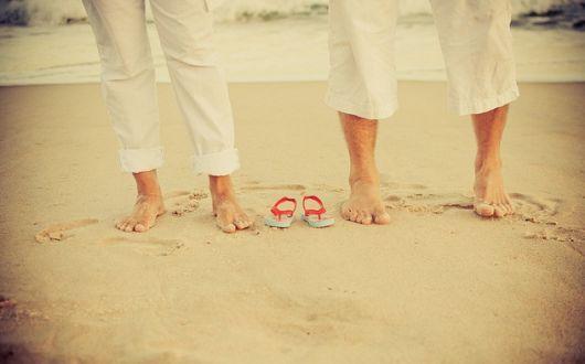 Ensaio de grávida com marido na praia