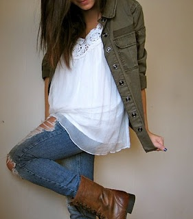 Army green jacket, girly white top, ripped jeans, and vintage lace-up boots.