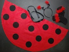 Begin by cutting a large semi-circle out of the red felt. Ours had a radius of 18 inches, however you may need to increase or decrease this depending on how long you want the cape to be. Cut a shallow semi-circle from the center edge of the large one to make a space for your child's neck. Glue round circles of black felt onto the red cape, and glue the length of ribbon around the neck. Cut two 1 inch pieces of red trim and attach to the headband using pipe cleaners. Glue the remaining ...