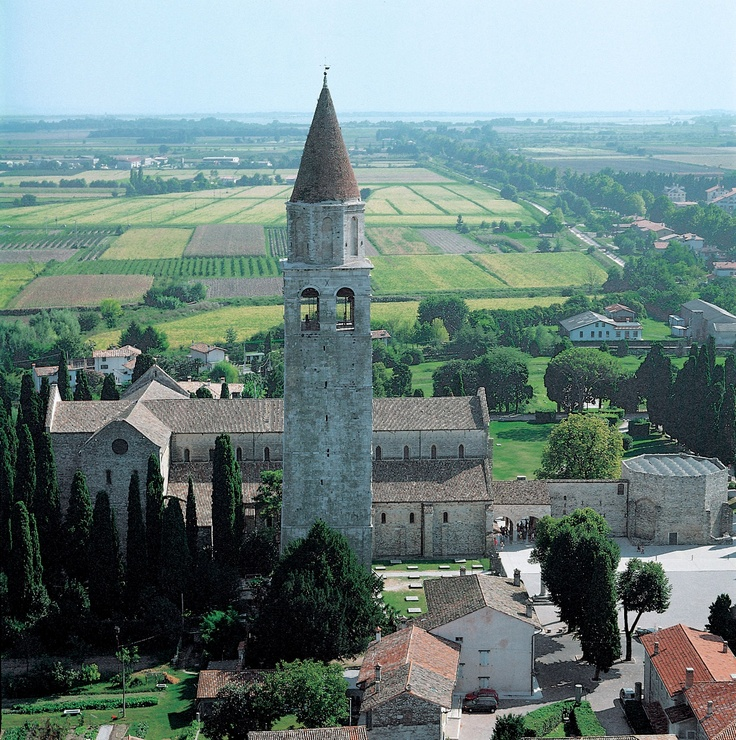 Aquileia, Italy (via Italy.it) - Aquileia: on the trail of the Roman Empire - Udine, Friuli Venezia Giulia - As evidence of its splendour during the Roman era, Aquileia still owns a vast archaeological site, where it is possible to admire many artefacts, including the ruins of the forum, the burial ground, the river port and some houses.
