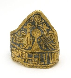 The Aethelwulf ring.  Gold/niello.  Late Anglo-Saxon (828-858).  Found in a cart rut, Laverstock, Wiltshire.  Inscription: + ETHELVVLF RX.  Diam 2.8 cm.  British Museum.