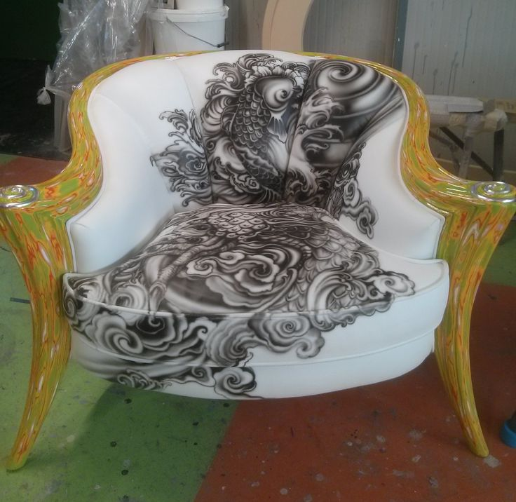 Upholstery in leather with handmade tattoo