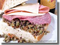 Muffaletta Olive Salad..From Kevin D. Weeks...the olive mix served on the famous New Orleans Mufaletta sandwich....invented at Central Grocery.  Ideally it should be made a day in advance to give the flavors time to meld. This recipe makes a lot, but if kept sealed in a jar in the refrigerator it will keep for months.