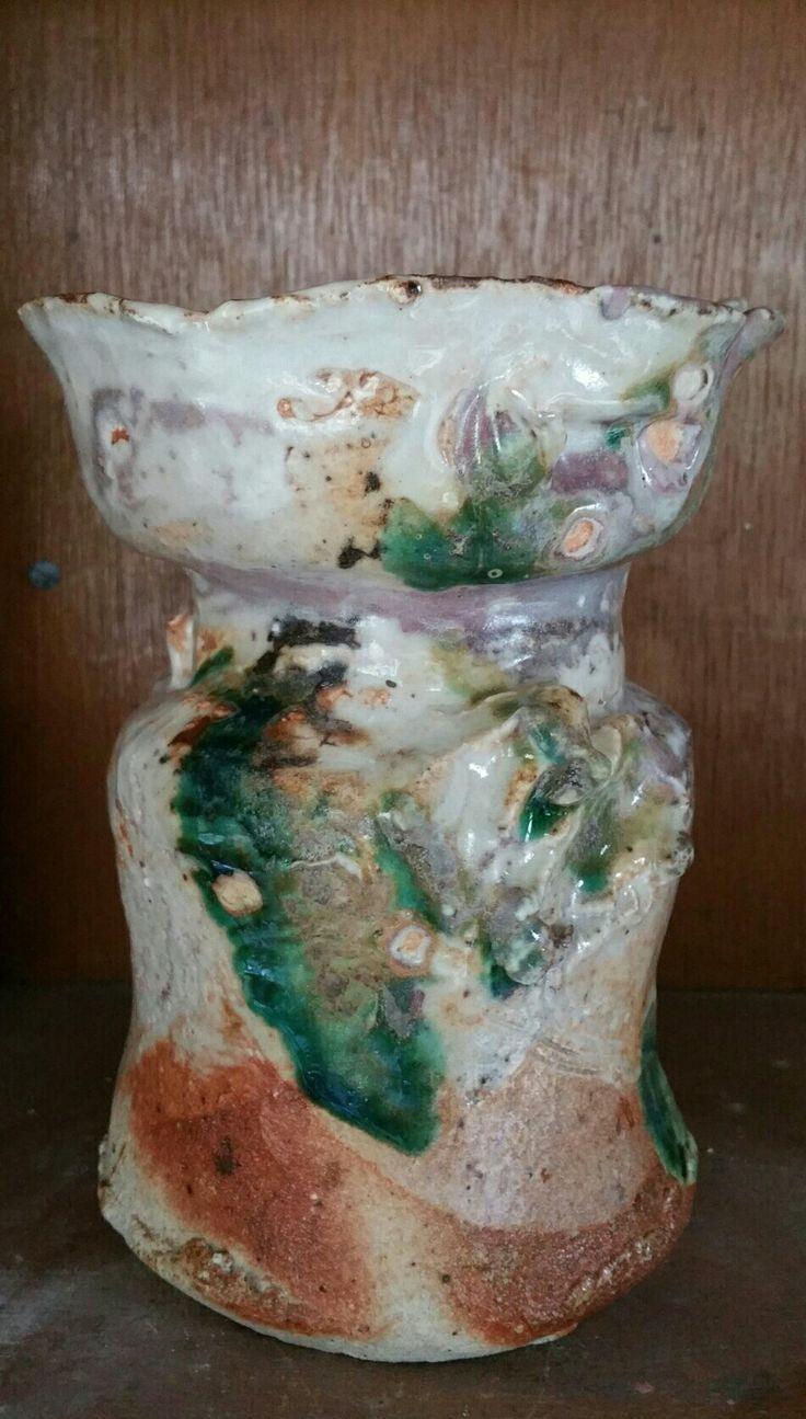 Vase form  25cm. Handbuilt from hybrid clays. Twice fired shino and oribe type glazes.