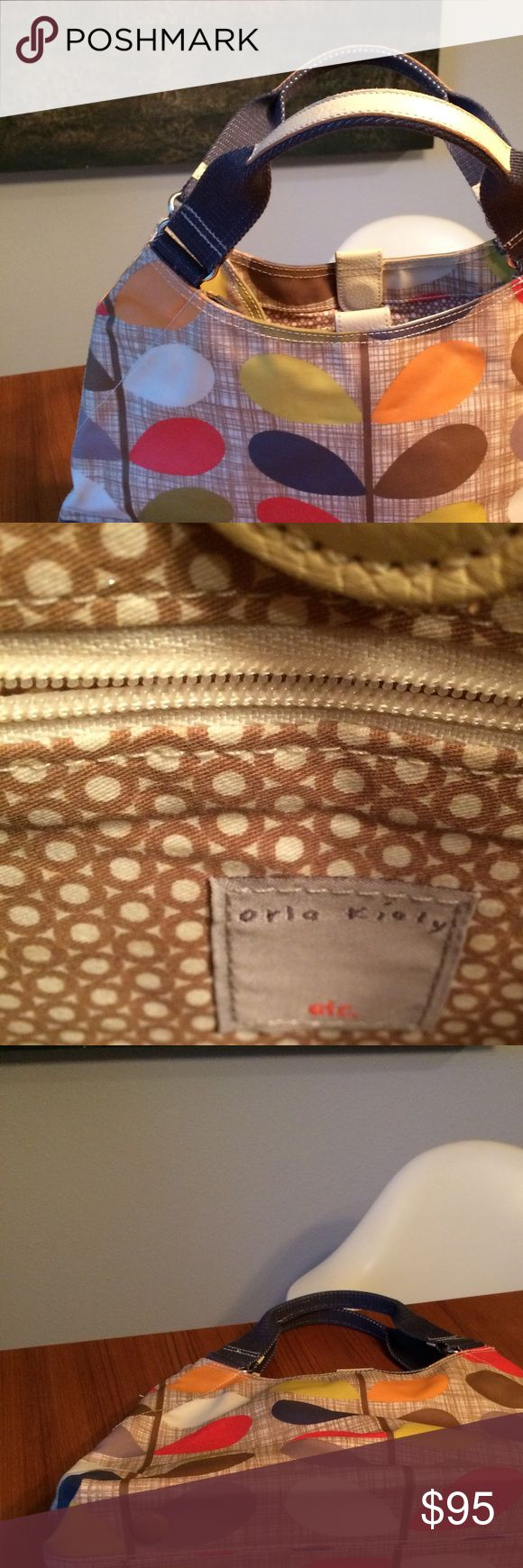 Orla Kiely purse like NEW Large hold all Sorry for the terrible pics. Poshmark is cropping my photos. I'll have to redo. Gorgeous Orla Kiely purse. Barely carried. Excellent condition. Orla Kiely Bags Totes