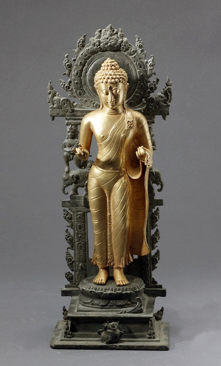 Indonesian Gold Sculpture of a Buddha with a Bronze Base