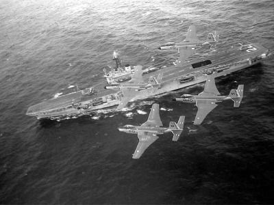 """""""Four Mc Donnell F2H-3 Banshee of the Royal Canadian Navy in flight over the aircraft carrier HMCS Bonaventure in the late 1950s."""""""