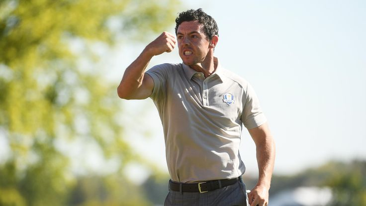 On the charge: Rory McIlroy, who enjoyed an unbeaten day in partnership with Thomas Pieters, of Belgium, reacts after holing a birdie putt against Dustin Johnson and Brooks Koepka