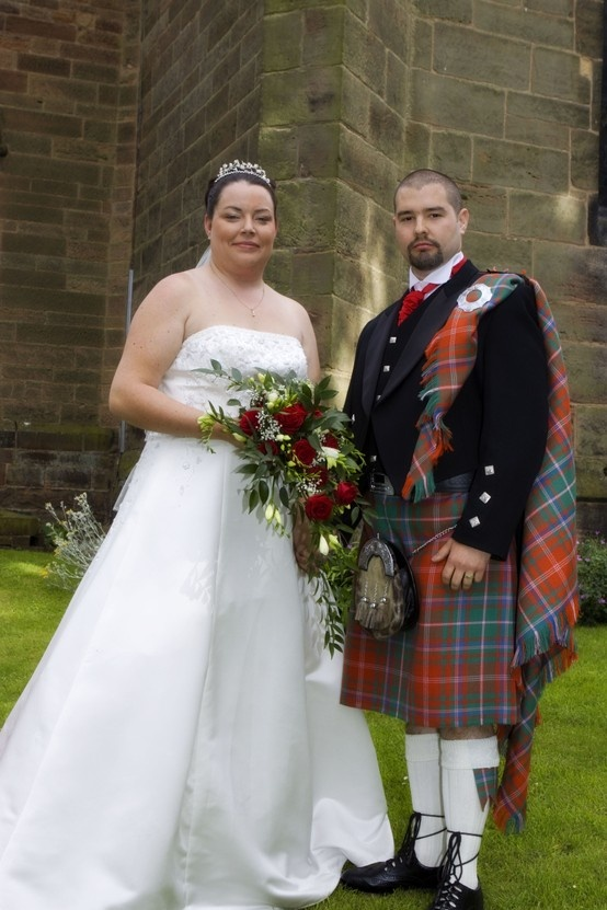 Mr and Mrs McDowell. Groom wears the MacDougall Ancient tartan with matching fly plaid. It's a great look.   Kilt can be purchased as part of our Prince Charlie outfits   http://buyakilt.com/kilt-outfit-packages/prince-charlie-kilt-outfits