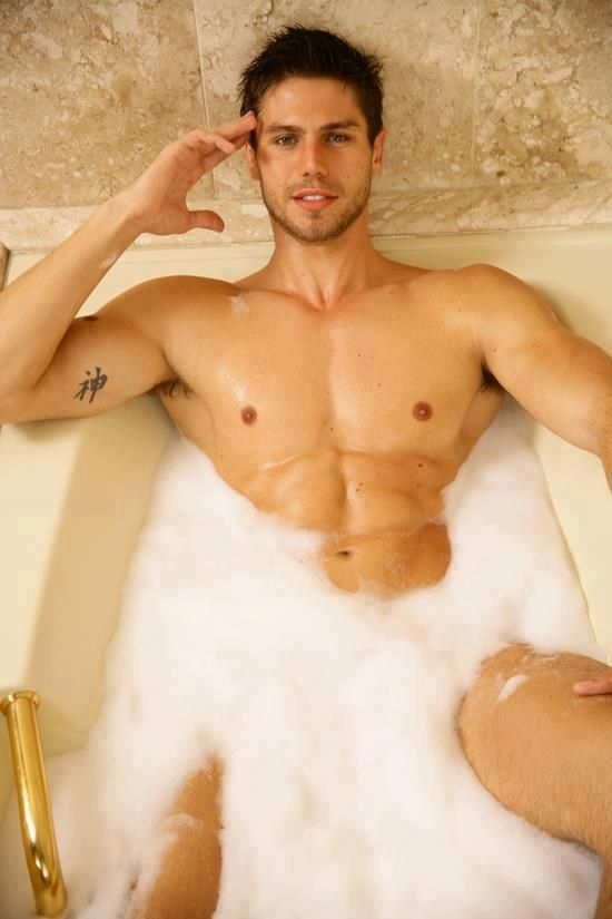 Something Naked men in a bathtub for