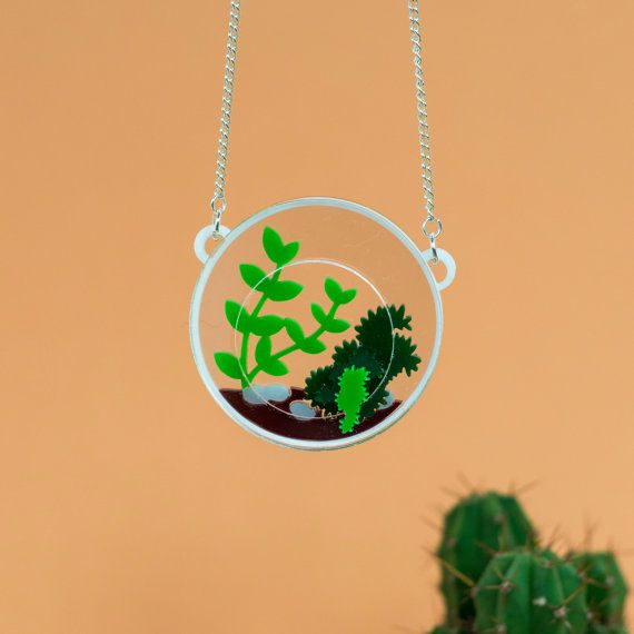 An intricate and unique terrarium necklace, perfect for lovers of unusual jewellery. A fabulous gift for the contemporary jewellery wearer,