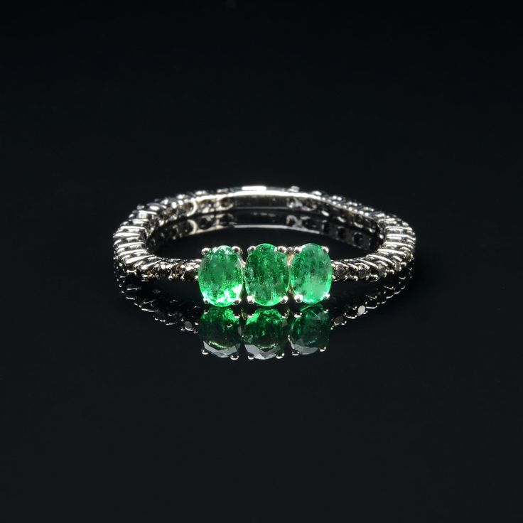 Ring in 18 kt gold with #emeralds of 0,60 ct and natural brilliant-cut black #diamonds of 0,17 ct. The #ring is available in white gold, rose gold, yellow gold but you can also customize carats, quality, and color of #gemstones. All our #jewelry are made in italy. Contact us for any particular request.