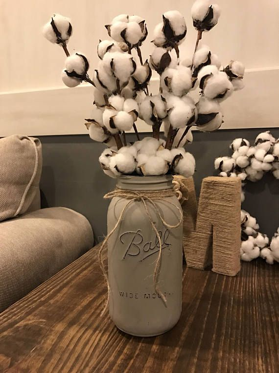 This listing is for a simple and adorable Half Gallon Painted Mason Jar with Cotton Bill Stems! Cant go wrong with some good ole cotton in the home! Perfect touch for the rustic farmhouse look :) Purchase includes the cotton stems!!!! :)  You can choose your jar color too!! :) Match your decor! Cool thing with cotton is it is neutral and goes with anything!  Each purchase comes with a hand painted and slightly distress HALF GALLON mason jar. The jars are accented with twine. Also includes 3…
