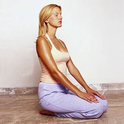 beat bloat with yoga seated heart opener use this move