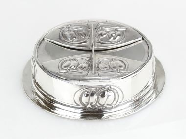 Tudric pewter silver plated inkwell with clear glass liners designed by Archibald Knox for Liberty & Co Circa 1902  In very good condition with some slight wear to the plating.   18.5cm diameter  Marked to base   TUDRIC 0163