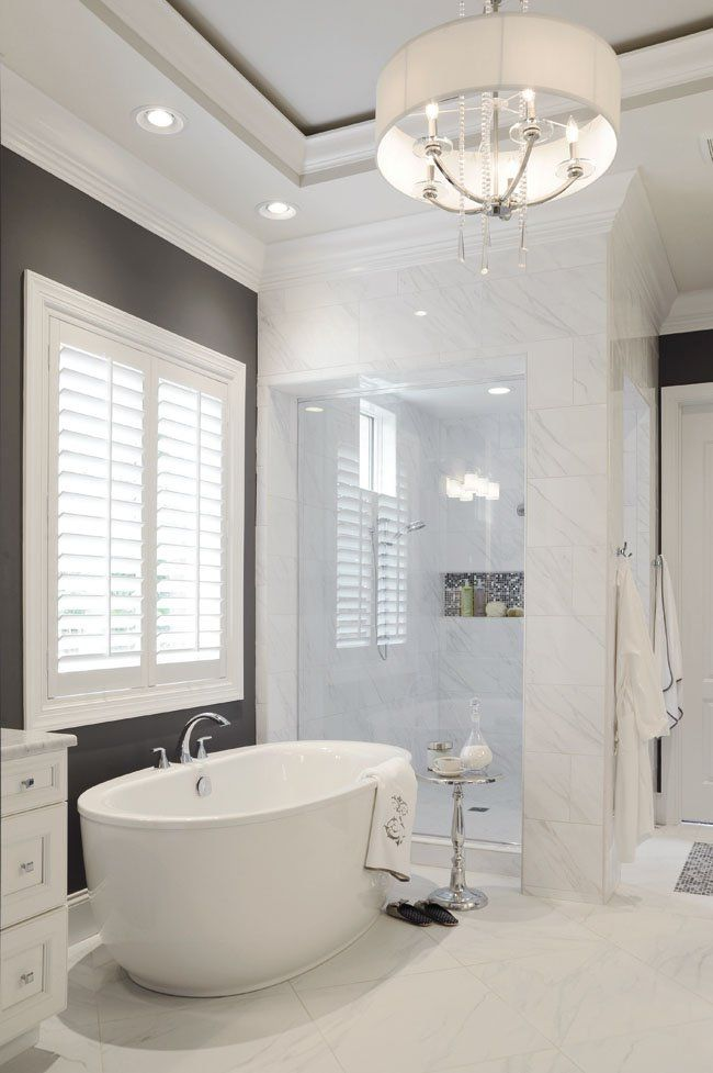 Natural light shines on this Kohler tub and nearby space