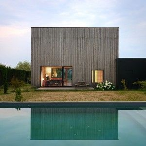 """Timber-framed """"bioclimatic"""" house  with larch cladding by Tectoniques"""