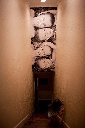 Stairwell photo. This is one of the best ideas for that waste of space above the stairs! @ DIY Home Ideas