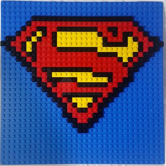 This is a handmade mosaic of Supermans logo using LEGO plates. The pieces are glued down and the mosaic measures 25.5cm x 25.5cm.  These are made
