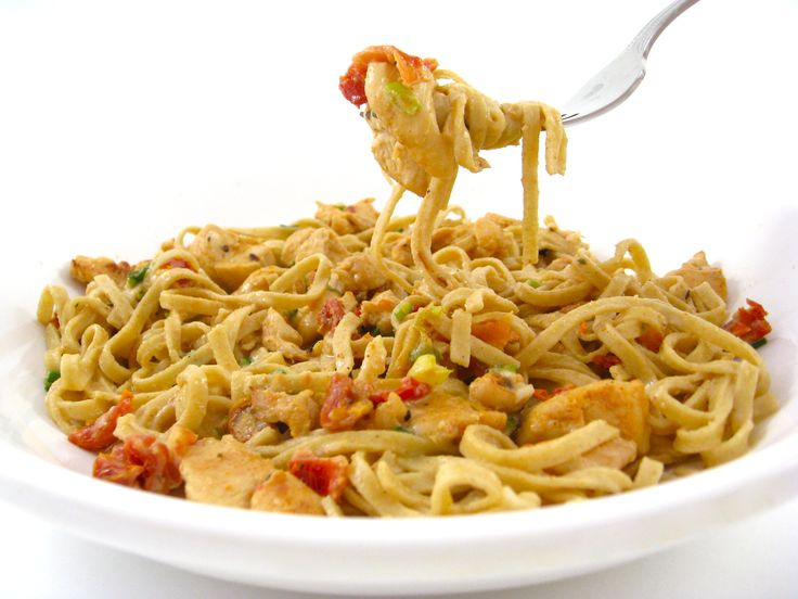 Skinny Kitchen Spicy Cajiun Chicken Alfredo. A bit spicy, a bit creamy, this decadent pasta brings a classic Chicken Alfredo to a whole new level. It's bursting with flavor and spice thanks to the Cajun seasonings.