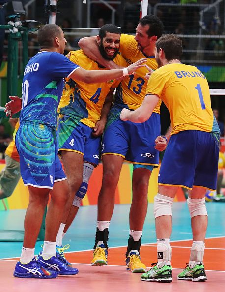 Wallace de Souza of Brazil is congratulated by team mates during the Men's Gold…
