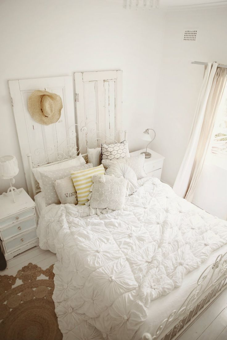coastal bedroom shabby vintage beachy chic abeachcottage.com blog whitewashed floors, casual jute rug, vintage doors, linen curtains, white ...