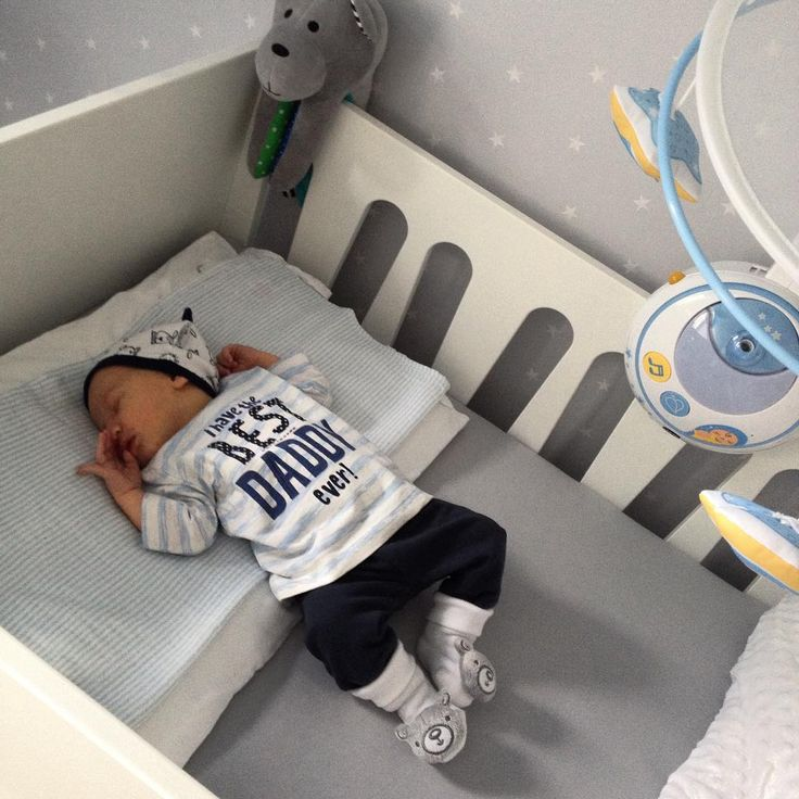 Well dressed Baby Boy sleeping in Funique's crib :)