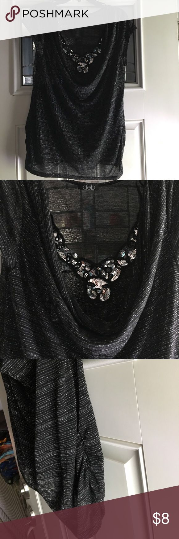 Nice Used Black and Silver Blouse Black with Silver scrunches on side. Size tag is missing Deb Tops Blouses