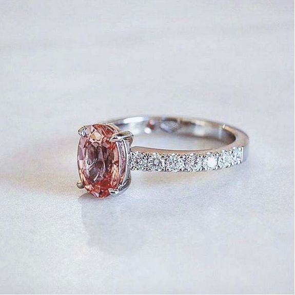 Naveya & Sloane bespoke oval cut pink sapphire, with a claw set diamond band. Crafted in platinum.