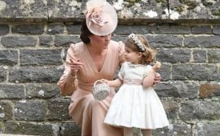 Catherine, Duchess of Cambridge and Princess Charlotte of Cambridge, a bridesmaid.