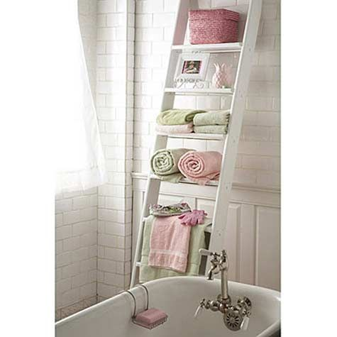 When decorating a small bathroom, you have to get creative with storage. The step ladder offers up some creative vertical storage. What a beautiful and practical way to utilize space.