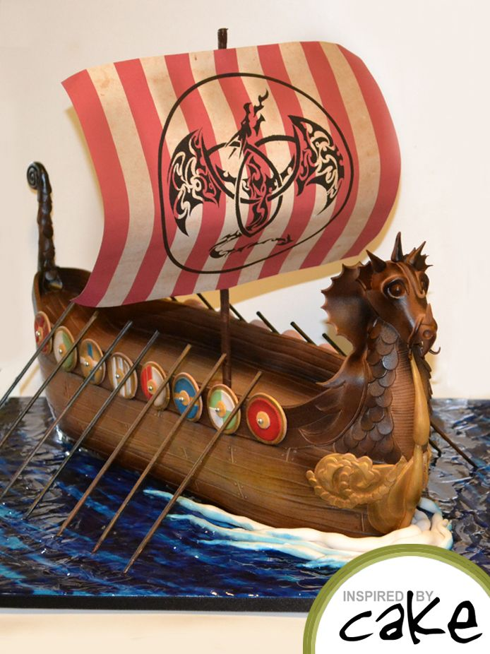 "First order of the week was for my Husbands Birthday!   It was all of his favourite things rolled into one.....Vikings, Dark Chocolate, Aniseed and Dragons. The Viking ship is 21"" long and 15"" high and is an Aniseed Infused Dark Chocolate Mud. I loved creating this and will probably cry when he cuts it!!!!!"