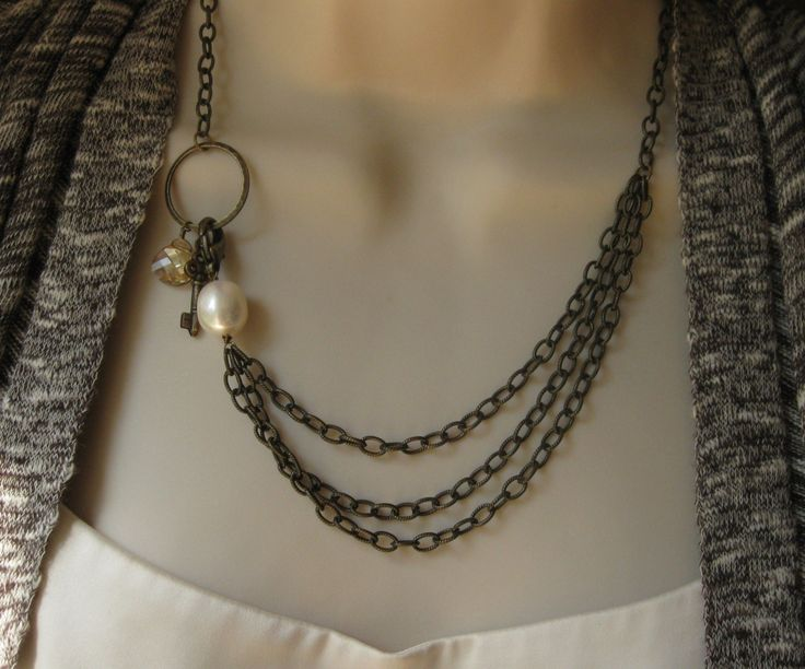 Treasures Necklace, Vintage Brass Chains and Charms, Multi Layer, with Swarovski Crystal. $49.00, via Etsy.