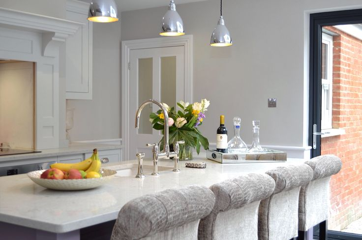Caesarstone Bianco Drift Quartz worktop, pendant lights by Jim Lawrence, Perrin & Rowe Polished Nickel tap. Stools by Shadrack Wallace of Ingatestone.
