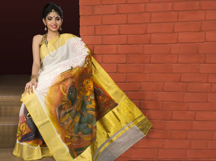 Pure kerala kasavu saree with rich golden zari borders and mural painting in borders and pleats .