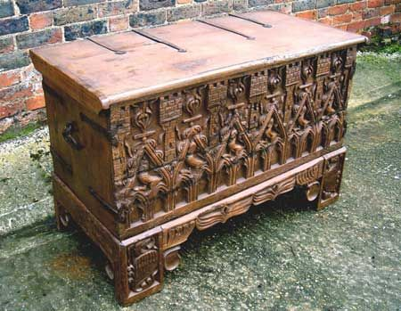 A Medieval Oak Chest Circa 1400. The front profusely carved with medieval beasts under Gothic arches situated between turrets.m A similar example in the Copenhagen Museum collection. Period restorations.   Extremely rare.    Width: 44.50 inches  Height: 29.25 inches  Depth: 21.75 inches