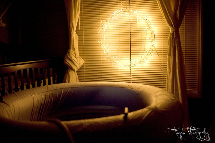 setting the mood for birth, so beautiful, probably not what my setup will be. i prefer the haphazard set up with target bags and a puke bowl instead of beautiful decorations. at least, i must, because thats how it always ends up!