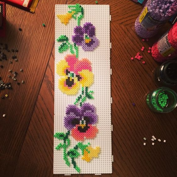 Pansies hama perler beads by villal8 - Pattern: https://www.pinterest.com/pin/374291419001893484/: