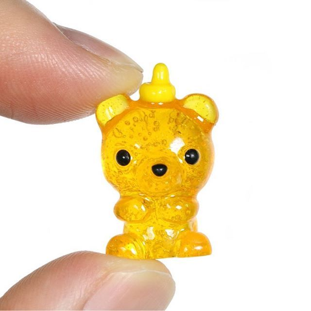 Tiny little honey bear bottle charm out of polymer clay and resin. Tutorial on my YouTube
