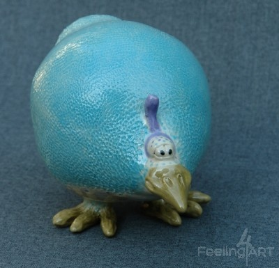 Ceramic bird.  Whimsical, so cute!