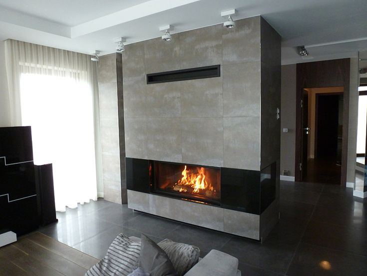 Beautiful fireplace with a modern stove with glass panoramic raised up. #panoramicfireplace