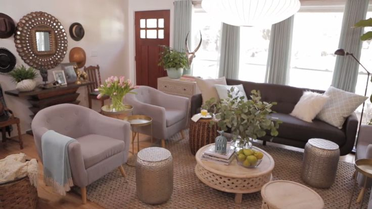HGTV Spring House's Cozy Living Room — Check out this living room that blends bohemian style and midcentury modern design. Brought to you by HGTV and @athomestores.
