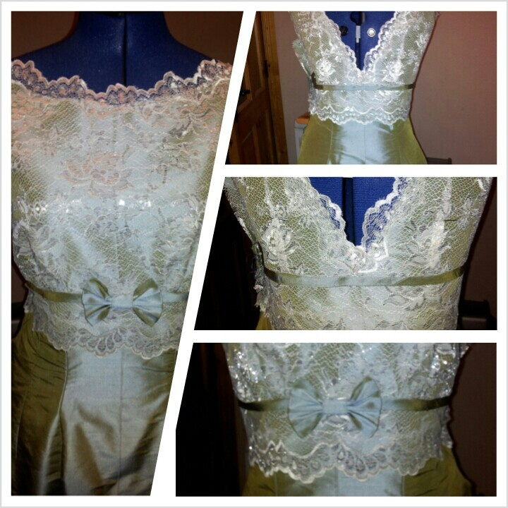 Actually wore this one myself. Vinyage style. Two tone shot silk. Ivory lace with silver detail.