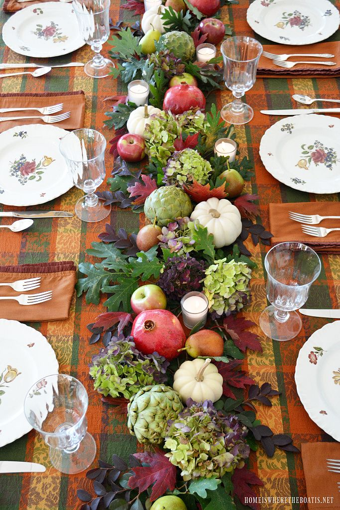 Fall table with beautiful organic table runner using hydrangeas, artichokes, leaves, pomegranates, pears, white pumpkins, apples and votives | homeiswheretheboatis.net