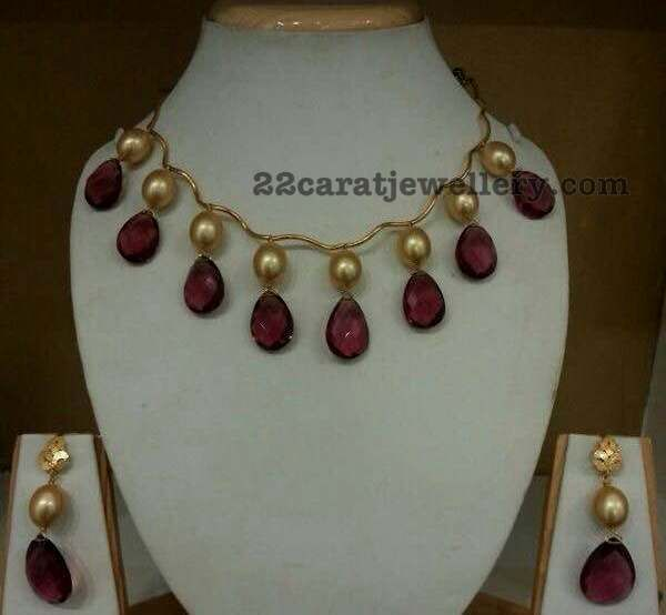 22 carat gold very simple yet trendy beads necklace. Large south sea pearls, tourmaline drops hanging necklace with drops earrings, whic...