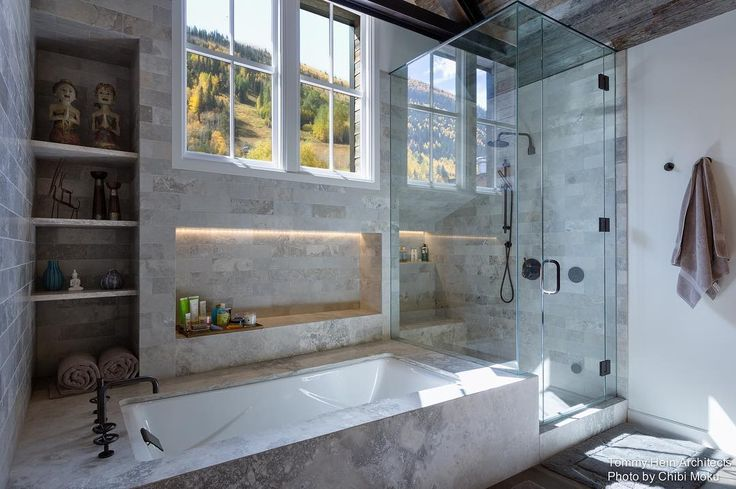 Integrated shower and tub encased in marble with a view of the mountains in this former train depot in Telluride Colorado. By Tommy Hein Architects and photographed by Chibi Moku. Visit our site for more. by roomporn