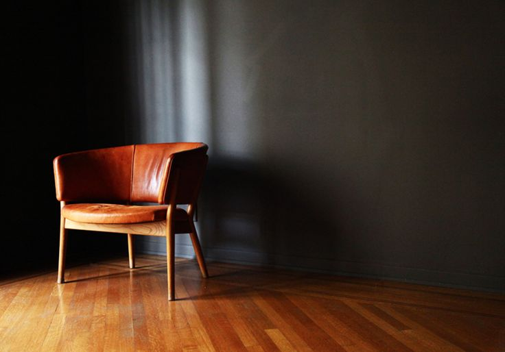 The 18 Most Gentlemanly Man Caves // leather chair, black walls