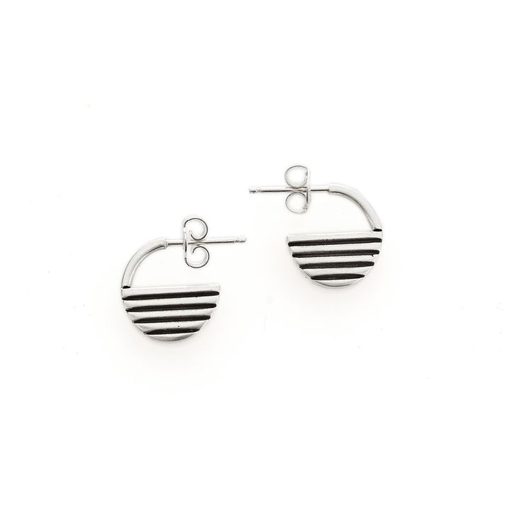 A pair of solid sterling silver, sunrise shaped earrings.