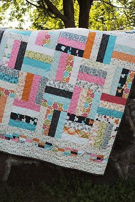 On The Fence Quilt Pattern. An easy strip piecing quilt.Use Layer Cakes,