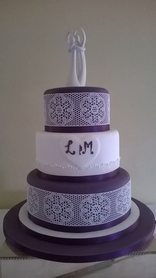 We loved making this purple and white wedding cake with lace detailing! How lovey is that topper?  #weddingcake #cake #belgianchocolate #chocolate #truffle #torte #buttercream #carrotcake #vanilla